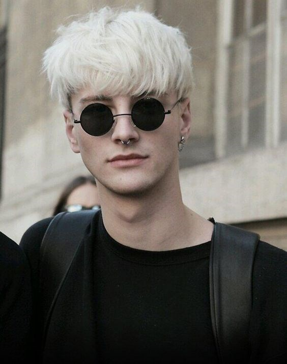 Bleached hair, sunglasses, septum ring, handsome man (Benjamin Jarvis, a comment says).